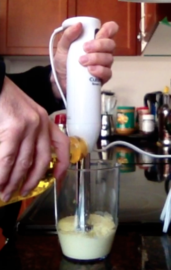 Picture of adding oil to mayonnaise